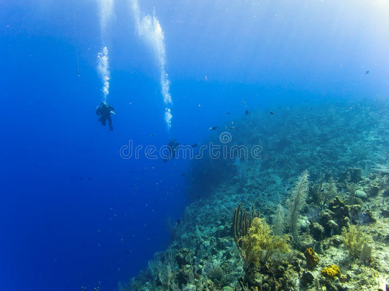 Scuba diving over a 6000ft abyss royalty free stock photos