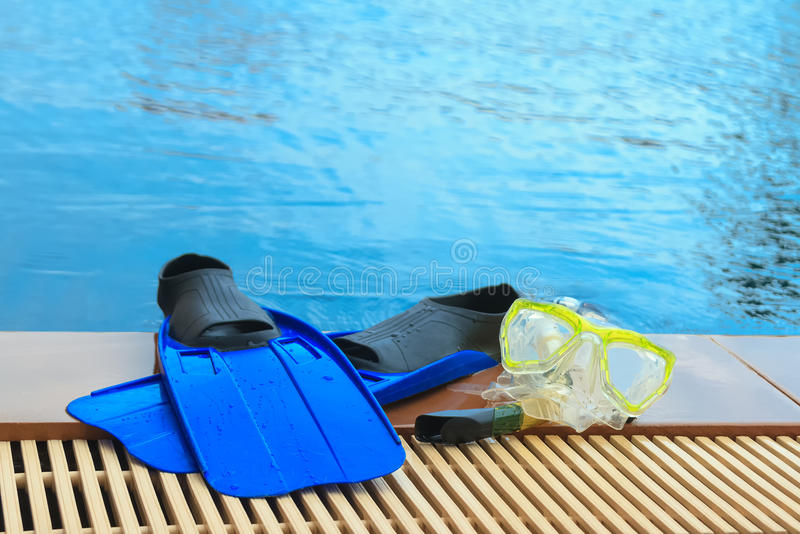 Scuba diving and snorkelling. Flippers, mask, snorkel. On poolside royalty free stock photo