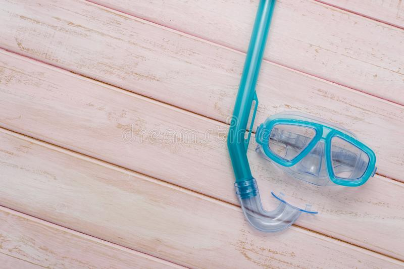 Scuba diving and snorkelling. Diving mask and snorkel on wood background.  stock photo