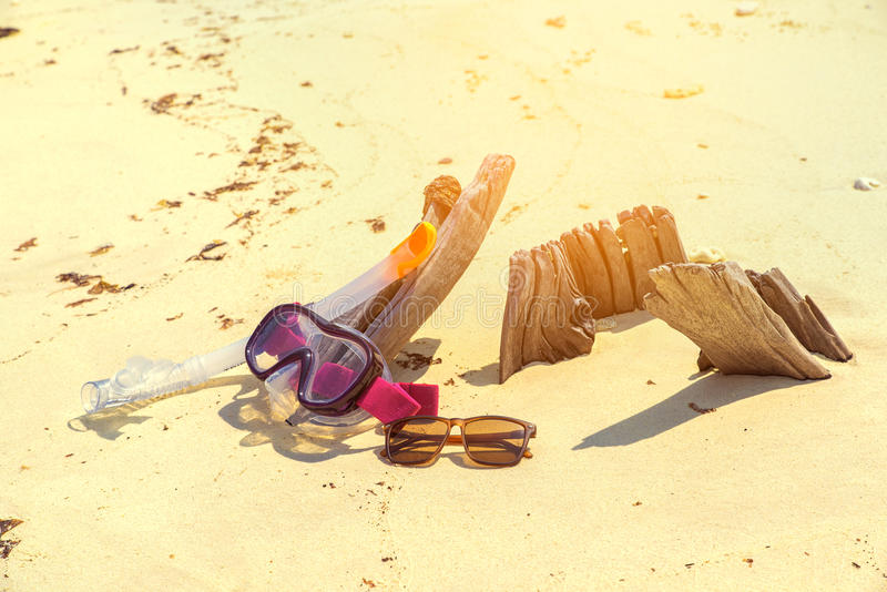 Scuba Diving Snorkelling And sunglasses On Timber beach Relax Summer Vacation Holiday Concept Toned. Scuba Diving Snorkelling And sunglasses On Timber the beach stock photo