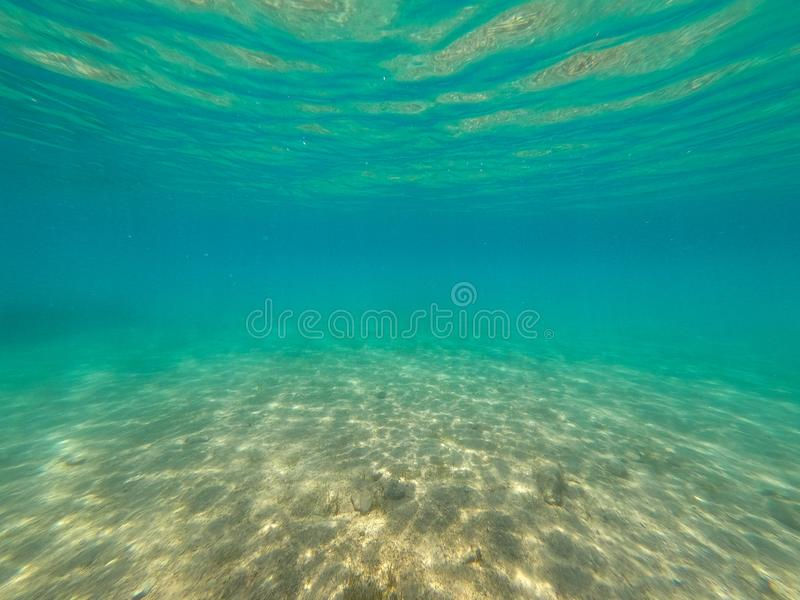 Scuba diving in turquoise colored sea royalty free stock photography