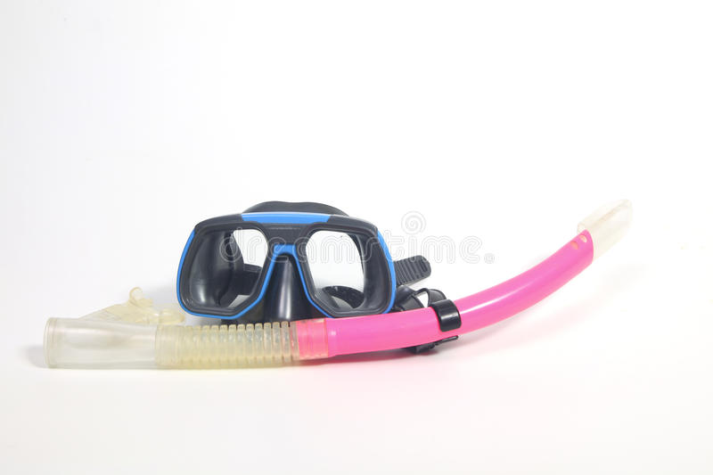 Scuba mask and snorkel. Blue scuba mask with pink snorkel royalty free stock photography
