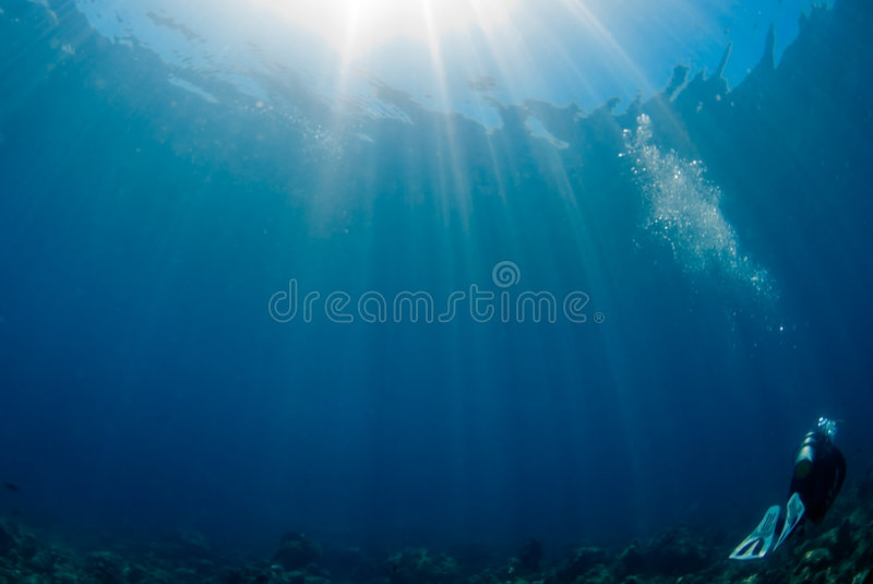 Scubadiver with bubbles. Scubadiver with air bubbles under the water surface royalty free stock photos