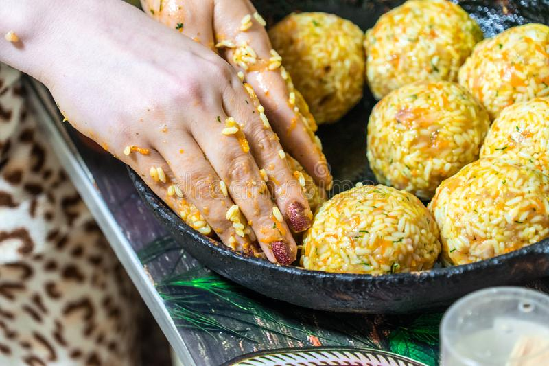 Sculpt meat meatballs with rice, carrots and herbs royalty free stock photos