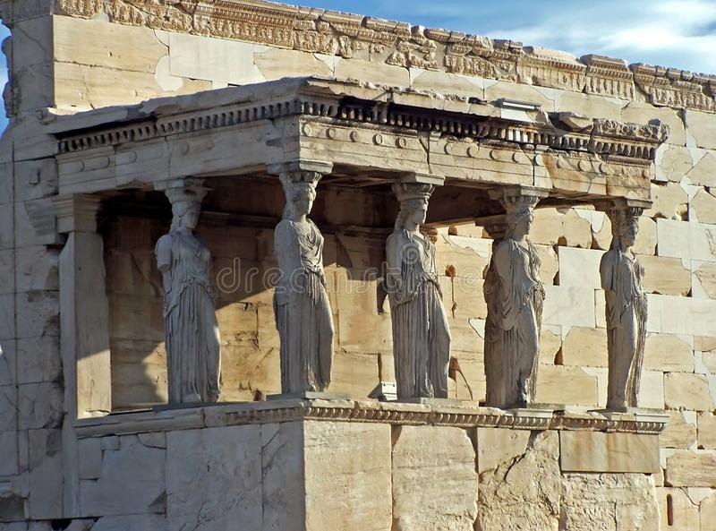 Sculpted female figures. Located on the north side of the Acropolis in Athens, Greece stock images
