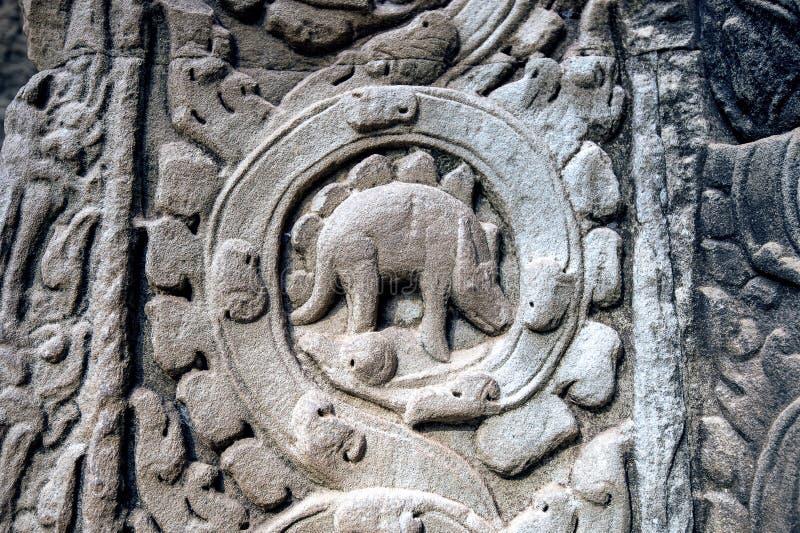 Sculpted stone depicting a dinosaur at the ancient Ta Prohm temple at Angkor Wat. Sculpted stone depicting a dinosaur at the ancient Ta Prohm temple at Angkor royalty free stock photography