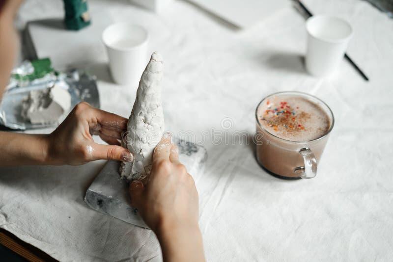 Sculpting from plastic mass of gypsum or ceramics. Women`s hands are preparing stock photo