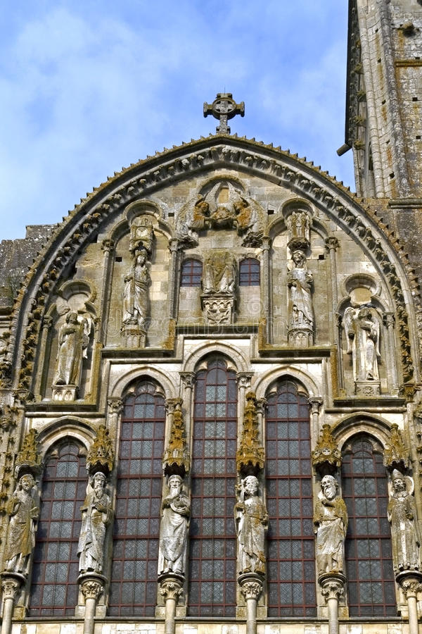 Sculptor art in frontage of church la Madeleine. France, department Yonne, region Burgundy, district Avallon: in the historical city center of the small town stock photography
