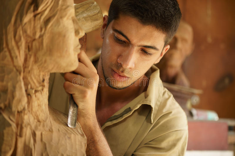 Sculptor young artist artisan working sculpting sculpture. Man, people, job, young student at work learning craftsman profession in art class, working with royalty free stock photos