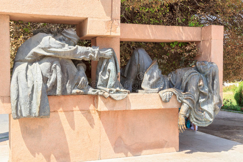 Sculptural composition on the area of S. Aini. Dushanbe, Tajikistan. August 14, 2014, Dushanbe, Tajikistan. Sculptural ensemble was opened in 1978. A sculpture royalty free stock photo