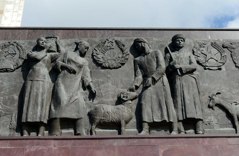 Sculptural composition-bas-relief at the foot of the monument `Worker and Collective Farm Girl` in Moscow. royalty free stock photography