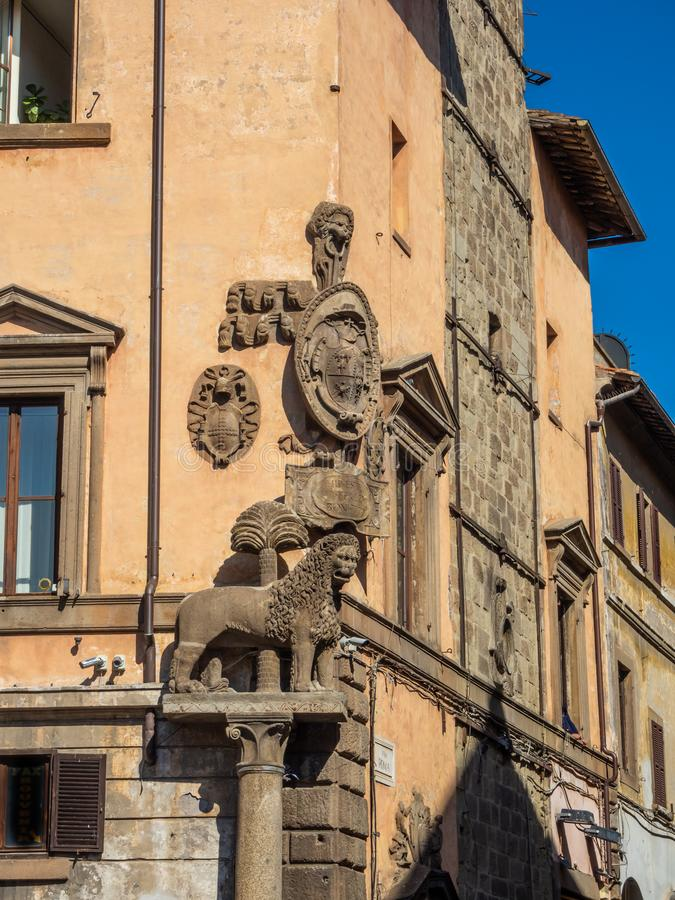 Sculptural composition on the wall of the house in the old town of Viterbo, Italy.  stock image