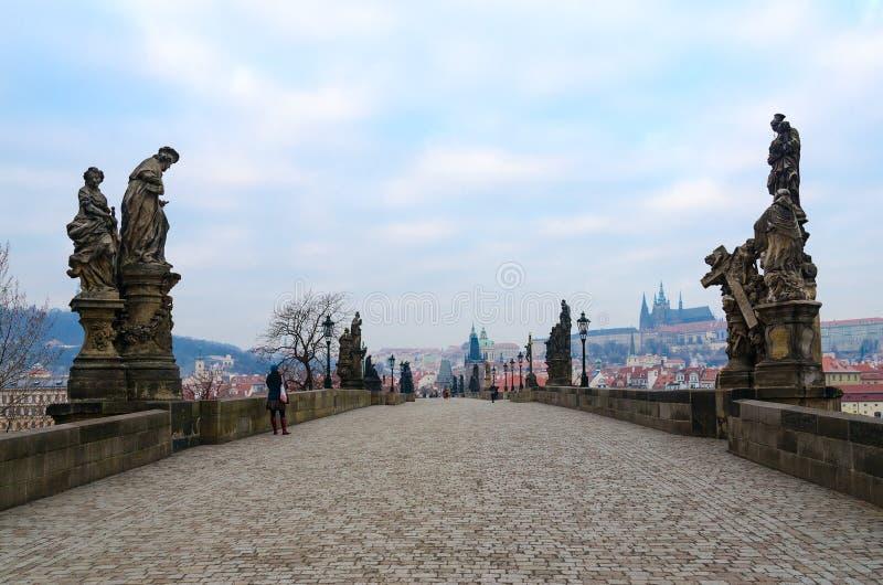 Sculptural compositions of Charles Bridge, Prague, Czech Republic. Madonna and St. Bernard. Saint Ivo, church judge. PRAGUE, CZECH REPUBLIC - JANUARY 22, 2019 royalty free stock photography