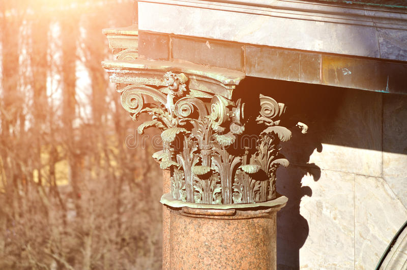 Sculptural details at the column of St.Isaac Cathedral in Saint Petersburg, Russia. Closeup view from the top under warm sunlight stock photos