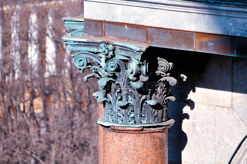 Sculptural elements at the column of St.Isaac Cathedral in Saint Petersburg, Russia. Closeup view from the top royalty free stock photos