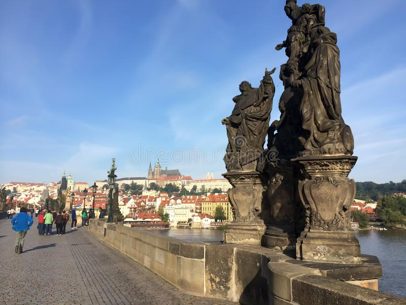 """The sculptural group """"Madonna, St. Dominic and St Thomas Aquinas"""" on the Charles Bridge, Prague, Czech Republic stock image"""