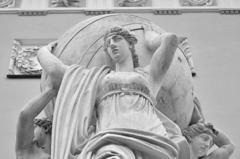 Sculptural group of sea nymphs bearing the earthly realm. Sculptural group of sea nymphs bearing the earthly realm near the Admiralty building in Petersburg stock photo