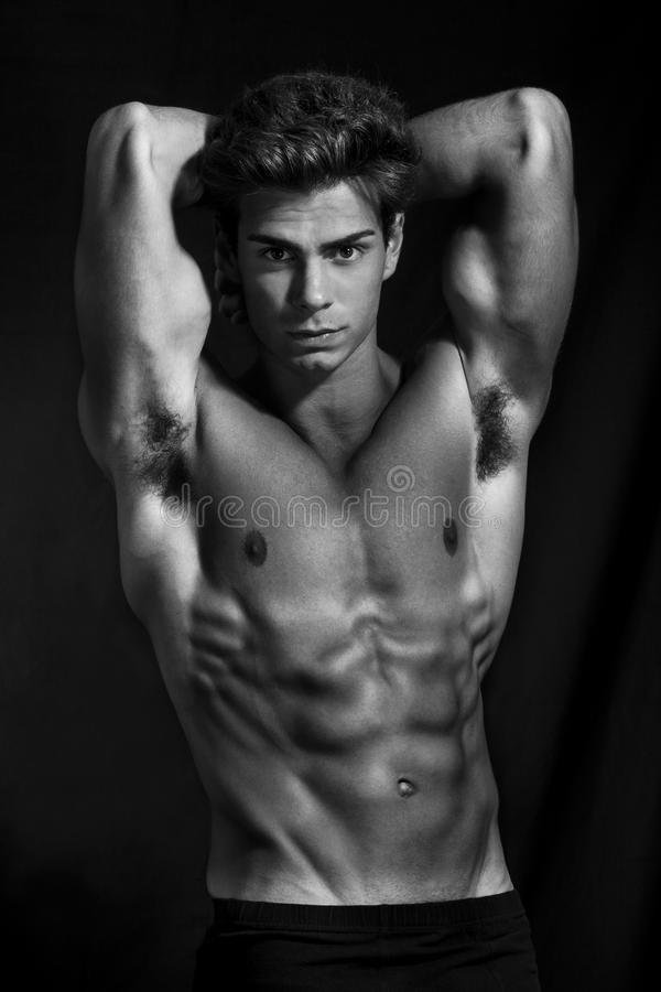 Sculptural man model perfect muscular body black and white royalty free stock images