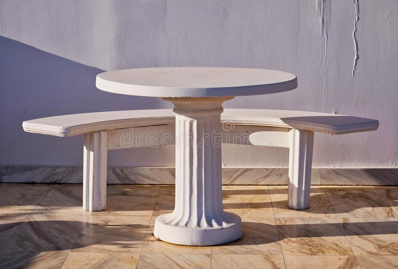 Sculptural Outdoor Table and Bench, Greece stock photo