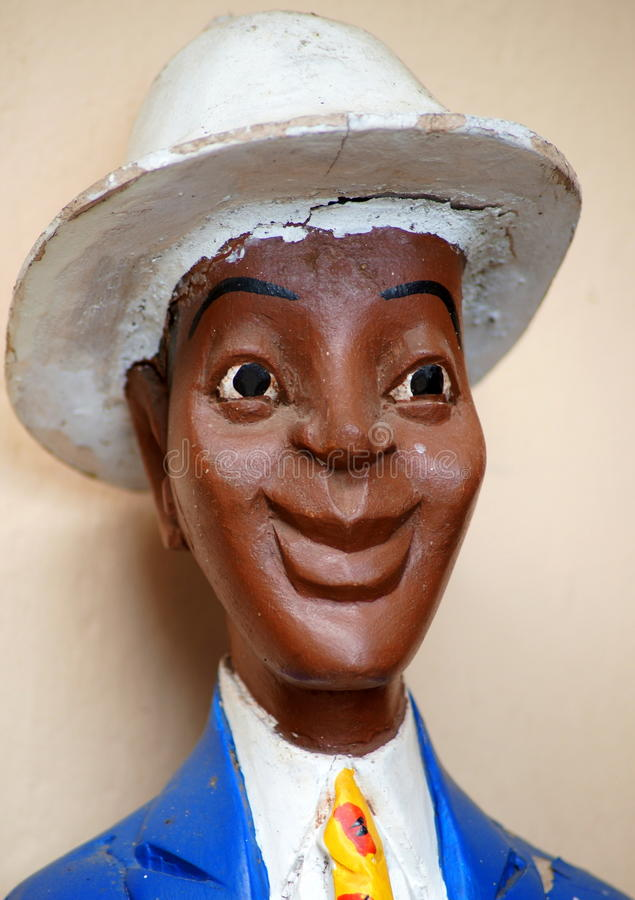 Sculpture of an African dandy. Sculpture of an African man on display in the cultural center of Arusha, Tanzania (East Africa royalty free stock image