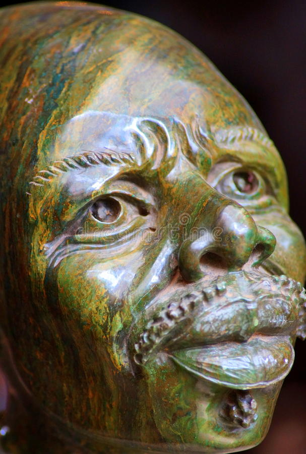 Sculpture of an African man. Sculpture of a man, made of Verdite (a semi-precious stone), on display in the cultural center of Arusha, Tanzania (East Africa stock images