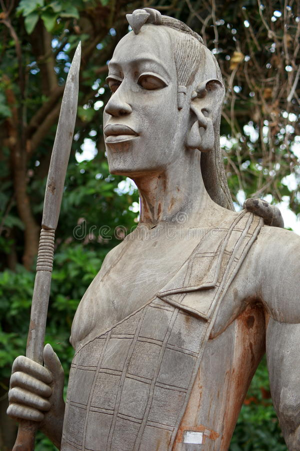 Sculpture of African warrior. Wooden sculpture of a warrior on display in the cultural center of Arusha, Tanzania (East Africa stock image