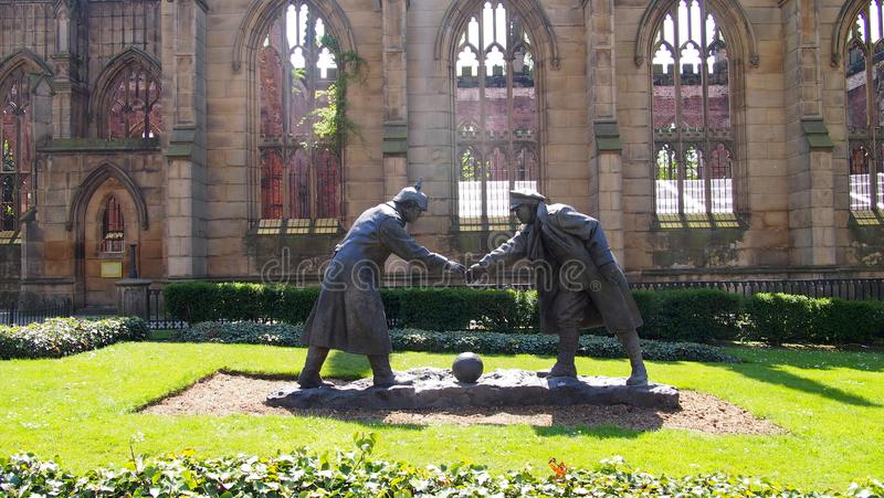 The `Truce`-sculpture in the city centre of Liverpool, England. The sculpture by Andy Edwards shows the moment when British and German soldiers called a royalty free stock photography