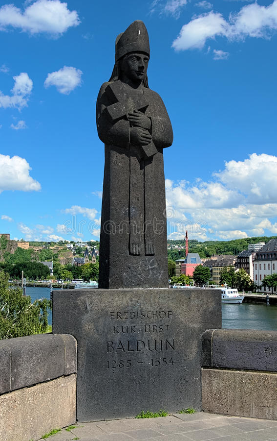 Sculpture of archbishop-elector Baldwin in Koblenz, Germany. Koblenz, Sculpture of archbishop-elector Baldwin on the bridge Balduinbrucke on background of the stock images