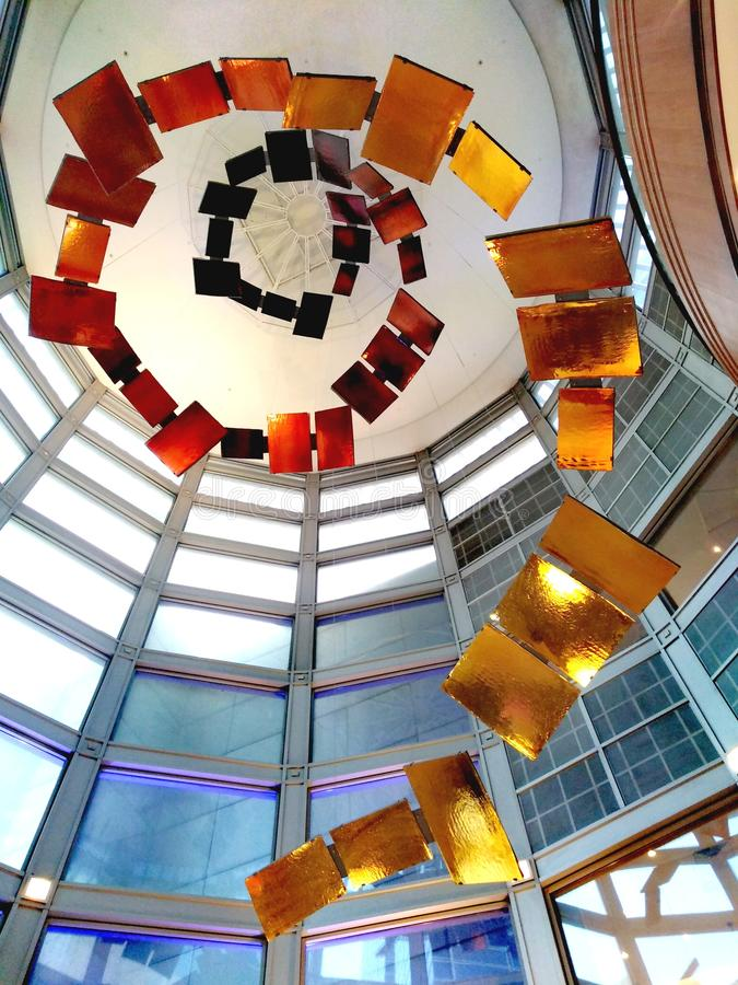 Sculpture art spiralling up the ceiling stock photography