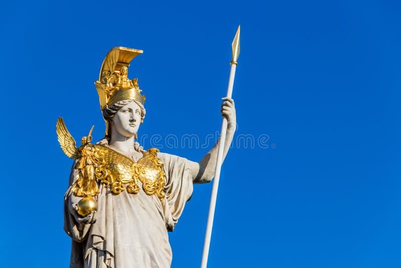 Sculpture of Athena, the Greek goddess of wisdom,outside the Austrian Parliament Building in Vienna, Austria stock photos