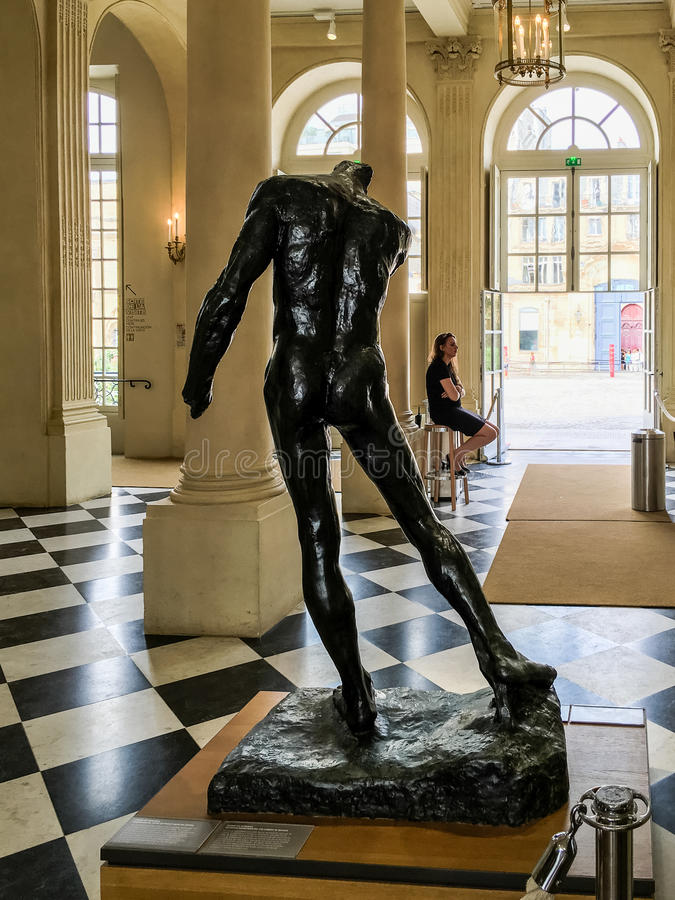 Sculpture and attendant in foyer of Rodin Museum, Paris, France, on a sunny summer day. Paris, France, summer 2016: Sculpture and attendant visible in foyer of stock images
