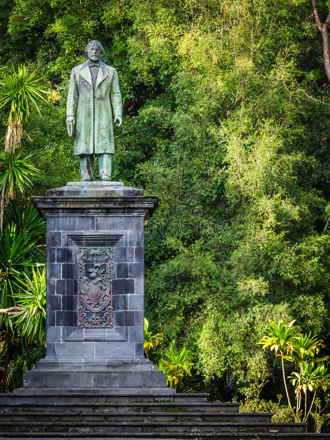 Sculpture in the botanical gardens. Man sculpture in the José do Canto Botanical Garden in Ponta Delgada, the capital of Sao Miguel island, Azores, Portugal royalty free stock photo