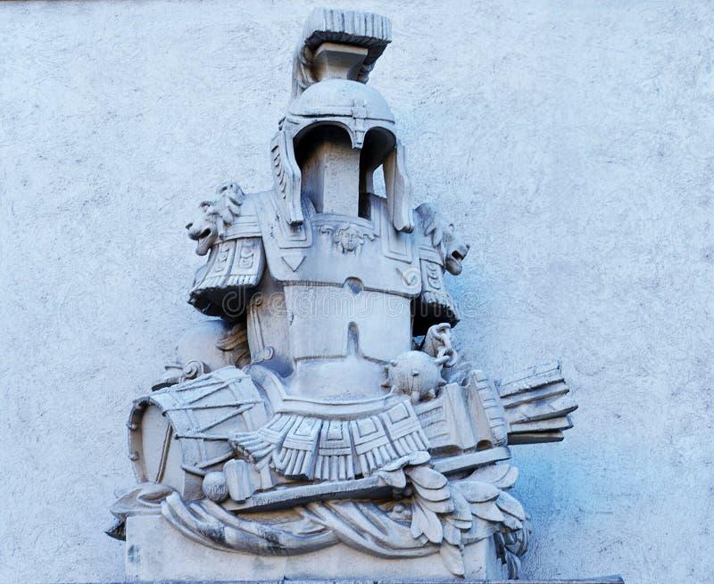 Sculpture : casque, armure et les piégeages de la guerre photographie stock