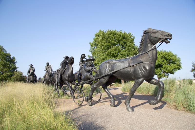Sculpture in Centennial Land Run Monument Oklahoma. Group bronze sculpture in Centennial Land Run Monument sunset, city Oklahoma USA royalty free stock photo
