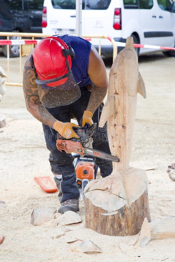 Sculpture with chainsaw. Wood sculpture competition with chainsaw, on July 27, 2019, in Alella, Barcelona, Spain stock image