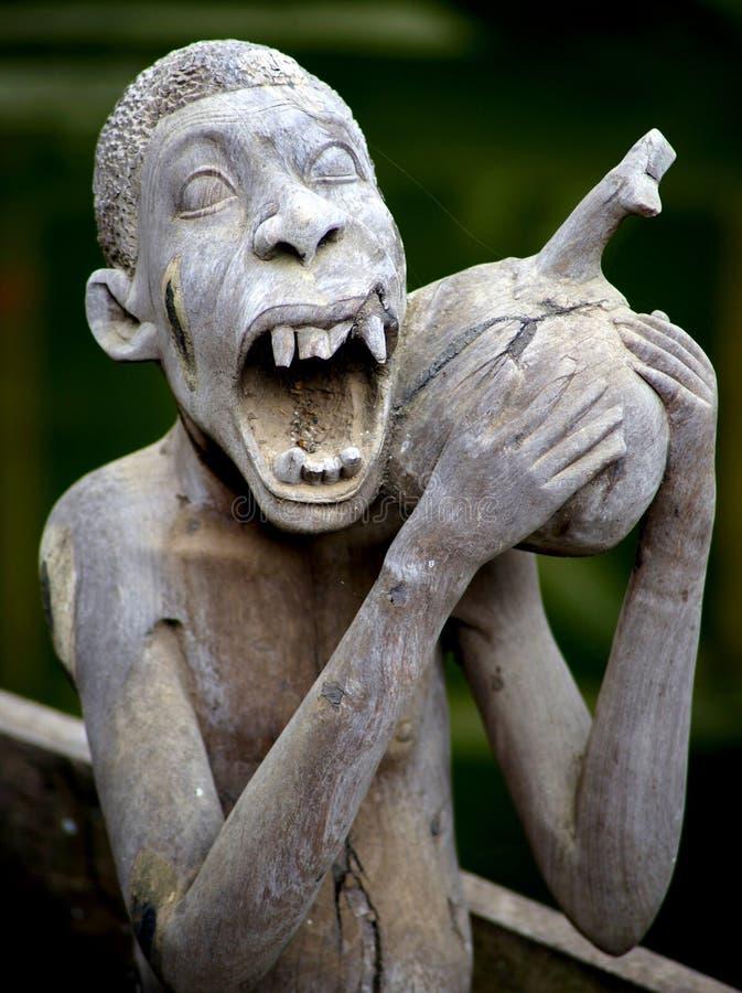 Assez Sculpture D'homme Africain Drôle Image stock éditorial - Image  DX43