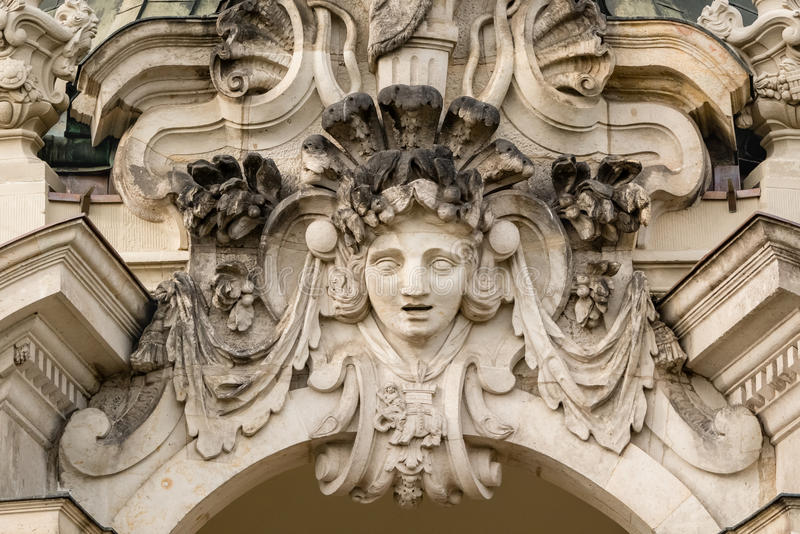 Sculpture decoration on the Crown Gate. Zwinger in Dresden, Germany. Travel photo. Sculpture decoration on the Crown Gate in Zwinger, palace in baroque style in stock photo