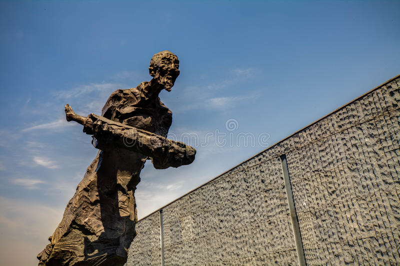 Sculpture, desperate dead grandfather holding grandson royalty free stock image