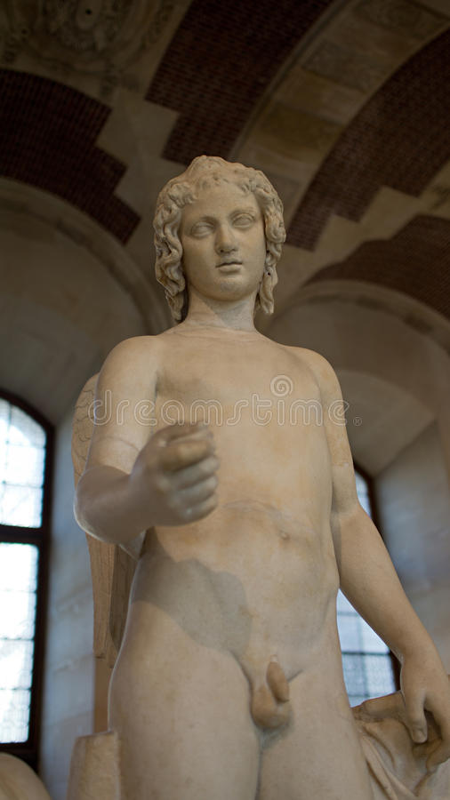 A sculpture on display in Louvre, Paris, France. stock image