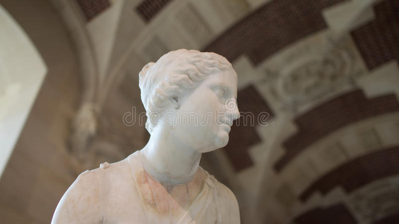 A sculpture on display in Louvre, Paris, France stock images