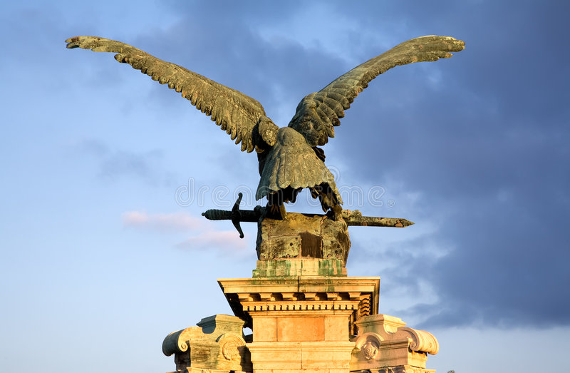 Sculpture of eagle. Antique sculpture of eagle in Budapest over blue sky stock photo