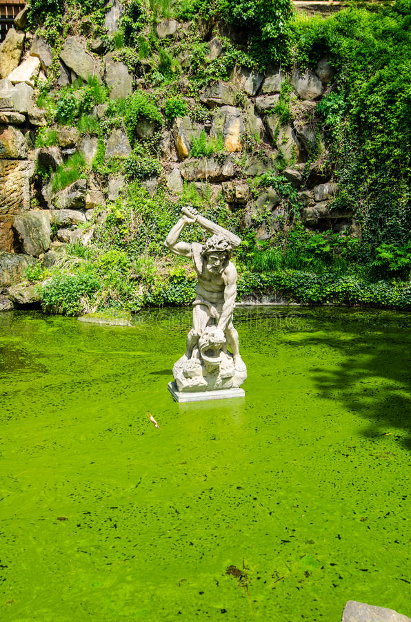 Sculpture in emeral water, Prague stock images