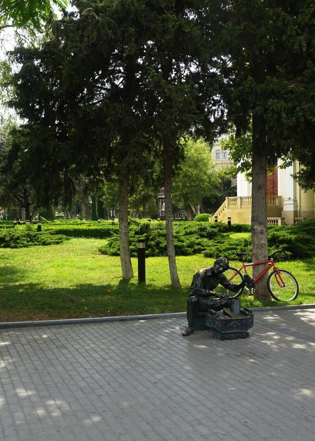 Sculpture en grand-papa de cirage en parc photographie stock libre de droits
