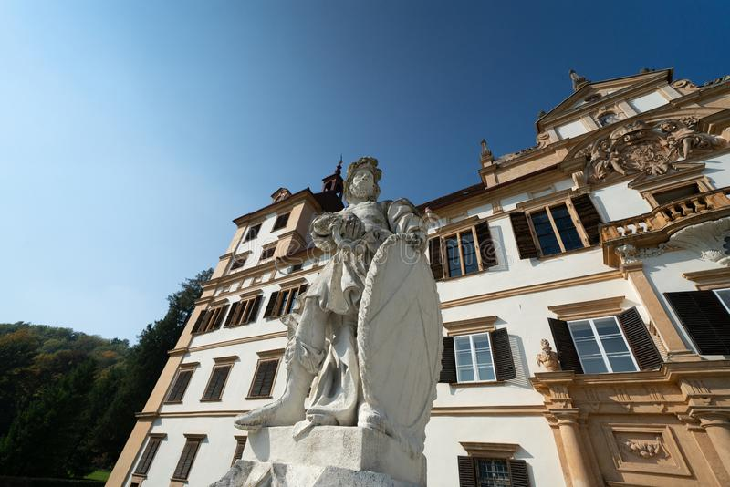 Sculpture at entrance of Schloss Eggenberg. This imposing sculpture stands at the front entrance to the medieval palace. The Palace facade is visible behind royalty free stock images