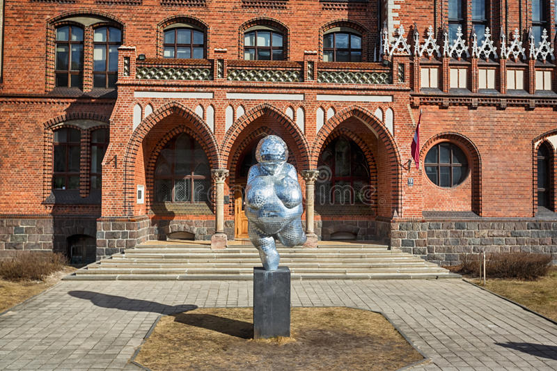 Sculpture of fat woman in Riga stock photography