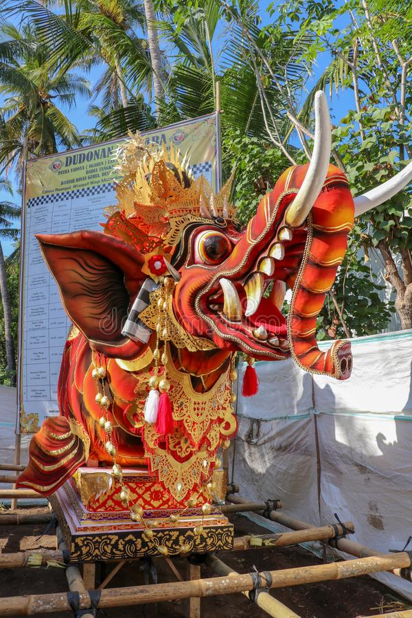 A sculpture of a fish with an elephant head, used during a funeral ritual and cremation on the island of Bali. The body of the dec stock photos