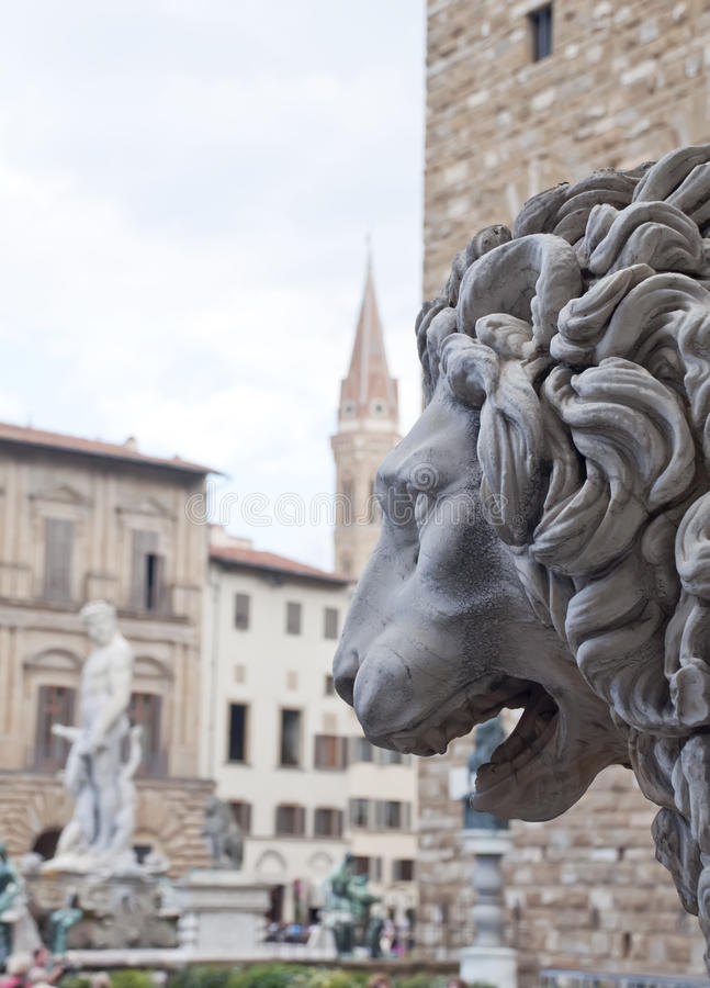 Sculpture In The Foreground Of A Lion Royalty Free Stock Photos