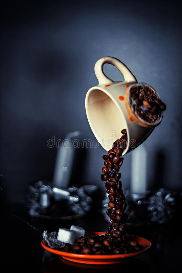 Sculpture in the form of a cup of coffee and flowing grains of coffee royalty free stock photos