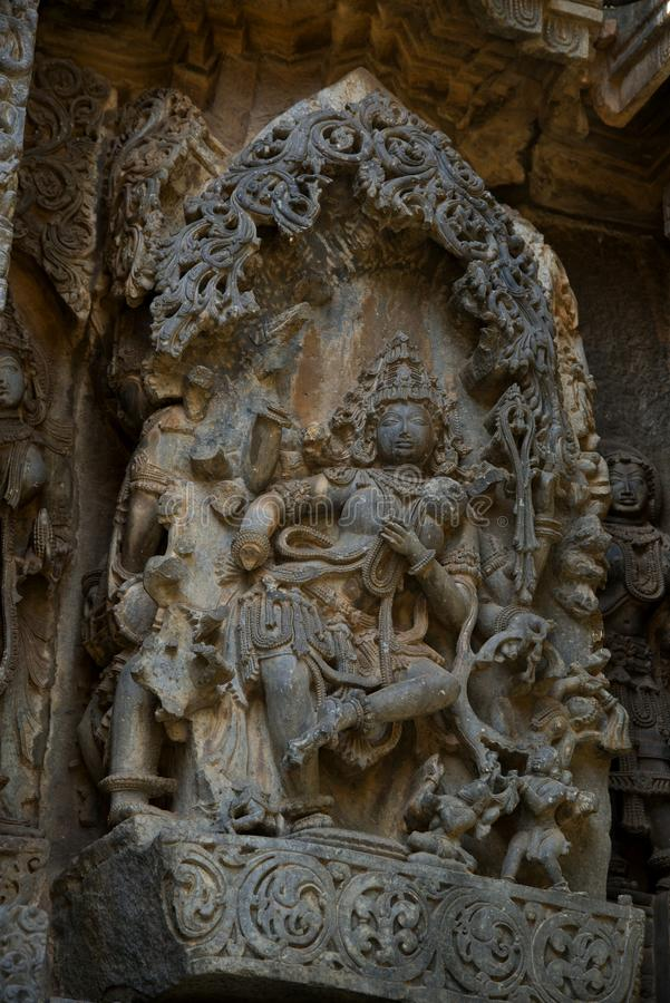 Sculpture and frieze on the outer walls of Hoysaleswara Temple at Halebidu , Karnataka, India royalty free stock photography