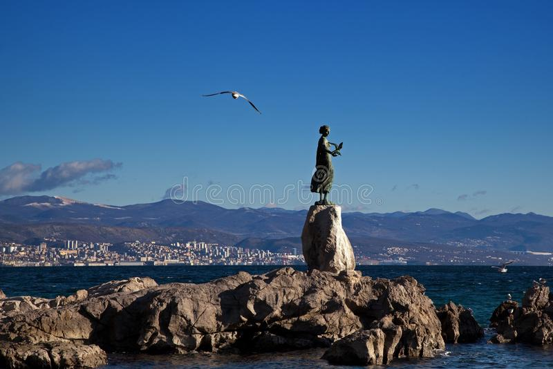 Sculpture of a girl with a seagull in Opatija, Croatia stock photography